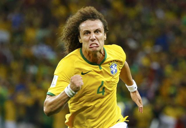 Brazil's David Luiz celebrates after scoring a goal against Colombia during their 2014 World Cup quarter-finals at the Castelao arena in Fortaleza July 4, 2014. REUTERS/Stefano Rellandini (BRAZIL - Tags: SOCCER SPORT WORLD CUP TPX IMAGES OF THE DAY)