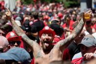 Liverpool supporters gather at a fan zone in Madrid (Photo by CURTO DE LA TORRE / AFP)