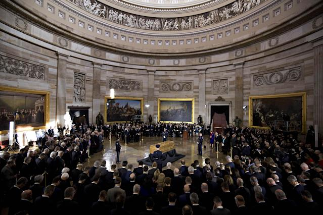 <p>The casket of the late Reverend Billy Graham, center, lies in honor during a service at the U.S. Capitol Rotunda in Washington on Wednesday, Feb. 28, 2018. (Photo: Andrew Harrer/Bloomberg via Getty Images) </p>