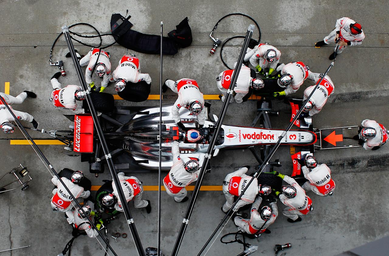 KUALA LUMPUR, MALAYSIA - MARCH 25:  Jenson Button of Great Britain and McLaren stops for a pitstop during the Malaysian Formula One Grand Prix at the Sepang Circuit on March 25, 2012 in Kuala Lumpur, Malaysia.  (Photo by Paul Gilham/Getty Images)