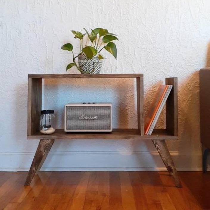 """A modern-looking side table with a compartment dedicated to storing all his <a href=""""https://subscribe.architecturaldigest.com/subscribe/architecturaldigest/130073?"""" rel=""""nofollow noopener"""" target=""""_blank"""" data-ylk=""""slk:favorite magazines"""" class=""""link rapid-noclick-resp"""">favorite magazines</a>. $135, Etsy. <a href=""""https://www.etsy.com/listing/866485399/midcentury-modern-magazine-side-table?gpla=1&gao=1&"""" rel=""""nofollow noopener"""" target=""""_blank"""" data-ylk=""""slk:Get it now!"""" class=""""link rapid-noclick-resp"""">Get it now!</a>"""