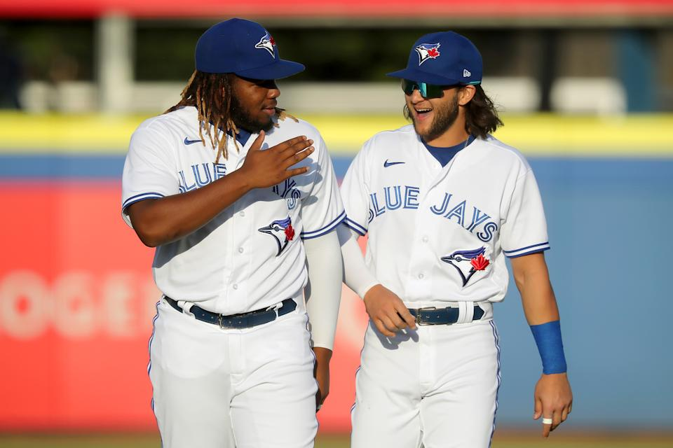DUNEDIN, FL - APRIL 28: Young superstars Vladimir Guerrero Jr. (27) and Bo Bichette (11) of the Blue Jays have some fun before the regular season game between the Washington Nationals and the Toronto Blue Jays on April 28, 2021, at TD Ballpark in Dunedin, FL. (Photo by Cliff Welch/Icon Sportswire via Getty Images)