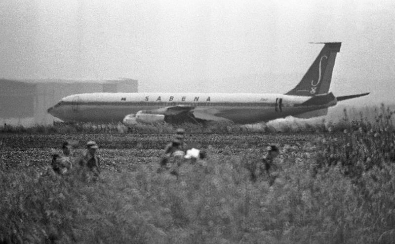 File - In this May 15, 1972 file photo, Israeli troops patrol fields around runway 26 where the Hijacked Sabena plane sits, crippled and unable to take off at Lod International Airport, Tel Aviv, Israel. When Prime Minister Benjamin Netanyahu had to fill a sensitive Cabinet post recently, he turned to an old army buddy from his days in an elite commando unit. His choice for minister of civil defense, Avi Dichter, replaced another graduate of the country's legendary Sayeret Matkal unit. As tensions heat up with Iran, Netanyahu appears to be relying too heavily some say on veterans of Matkal. Its supporters say the unit's outsize role is a testament to the intelligent, daring and creative qualities it requires from its members. (AP Photo, File)
