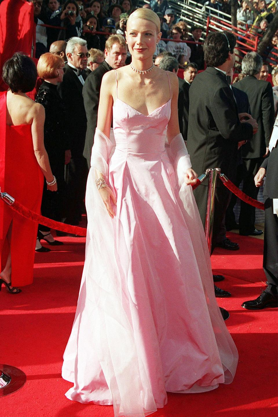 """<strong><h2>Gwyneth Paltrow, 1999</h2></strong><br><em>Pretty In Pink</em> might have starred Molly Ringwald, but Gwyneth Paltrow (that year's Best Actress winner for <em>Shakespeare in Love) </em> looked the part in this bubblegum pink number by Ralph Lauren.<br><br><em>Gwyneth Paltrow in Ralph Lauren. </em><span class=""""copyright"""">Photo: Frank Trapper/Corbis/Getty Images. </span>"""