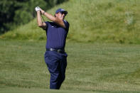 FILE - In this Aug. 20, 2020, file photo, Phil Mickelson hits from the rough on the 14th fairway in the first round of the Northern Trust golf tournament at TPC Boston in Norton, Mass. Mickelson will begin his preparation for the Masters in earnest on Friday, Oct. 16, 2020, at a place, and on a tour, not typically associated with the regimen required to win a major. The lefthander is making his second start on the PGA Tour Champions in the Dominion Energy Charity Classic at the Country Club of Virginia's somewhat forgiving James River course. (AP Photo/Charles Krupa, File)