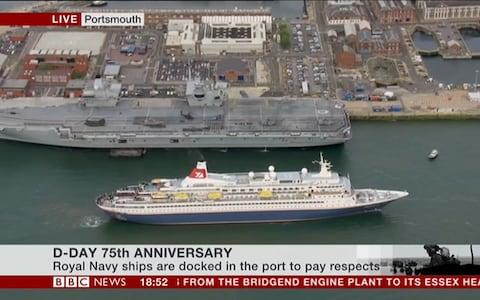 <span>The MV Boudicca passes the HMS Queen Elizabeth</span> <span>Credit: BBC </span>