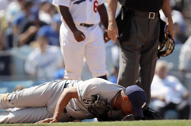 Christian Bethancourt on the ground after getting spiked on opening day. (AP)