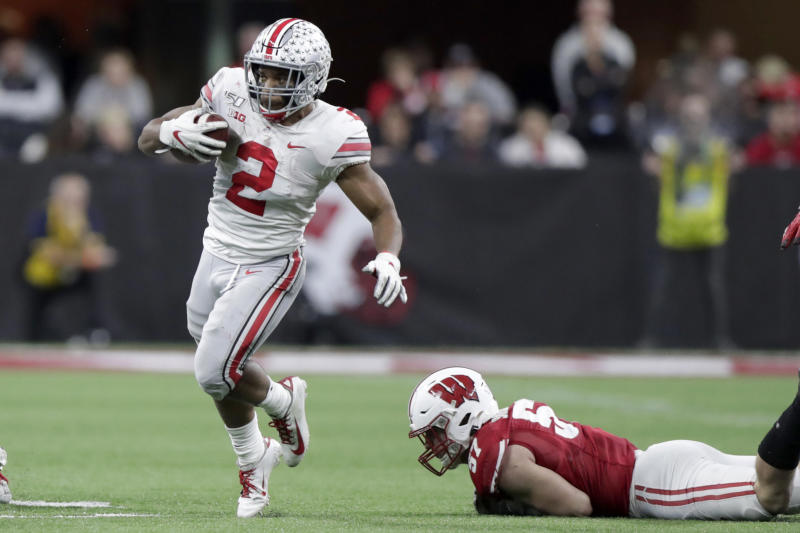 Ohio State running back J.K. Dobbins (2) runs past Wisconsin linebacker Jack Sanborn during the second half of the Big Ten championship NCAA college football game Saturday, Dec. 7, 2019, in Indianapolis. (AP Photo/Michael Conroy)