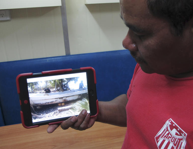 Willing Kajidrik, a sea patrol crew of the Marshall Islands Sea Patrol, shows a photo he shot of a fishing boat of Jose Salvador Alvarenga who was rescued by the crew, in Majuro, Marshall Islands, Sunday, Feb. 9, 2014. Salvadoran man Alvarenga, 37, washed ashore late last month. Alvarenga who says he spent more than a year drifting across the Pacific Ocean before making landfall in the Marshall Islands is too weak to travel and will remain in the island nation for a while, an official said Saturday. He was taken last week to the Marshall Islands' capital, Majuro, where he has been resting at a hotel. (AP Photo/Miki Toda)