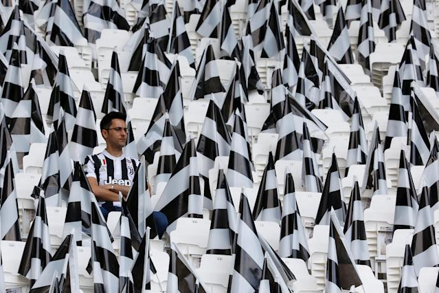 Soccer Football - Serie A - Juventus vs Hellas Verona - Allianz Stadium, Turin, Italy - May 19, 2018 Juventus fan in the stadium surrounded by flags before the match REUTERS/Stefano Rellandini