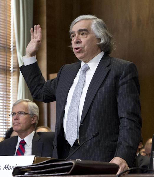 Energy Secretary nominee Ernest Moniz of Massachusetts, right, is sworn on Capitol Hill in Washington, Tuesday, April 9, 2013, prior to testifying before a Senate Energy and Natural Resources hearing on his nomination. At left is former New Mexico Sen. Jeff Bingaman, who once chaired the committee, and helped in introducing Moniz to the committee. (AP Photo/Manuel Balce Ceneta)