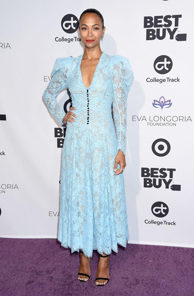 <p>On November 8, Zoe Saldana dressed in a lace midi dress by Erdem for an event in LA. <em>[Photo: Getty]</em> </p>