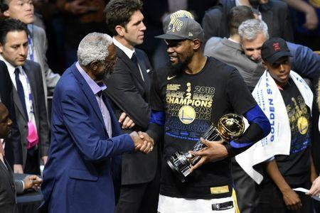 Jun 8, 2018; Cleveland, OH, USA; Golden State Warriors forward Kevin Durant (right) shakes hands with former NBA player Bill Russell after receiving the Bill Russell NBA Finals Most Valuable Player Award after defeating the Cleveland Cavaliers in game four of the 2018 NBA Finals at Quicken Loans Arena. David Richard-USA TODAY Sports