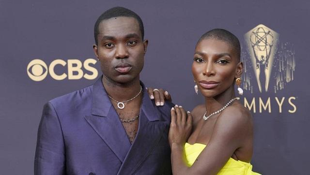 Michaela Coel in a bright yellow bandeaux top and matching skirt as she raced inside after closing down the carpet (AP Photo)