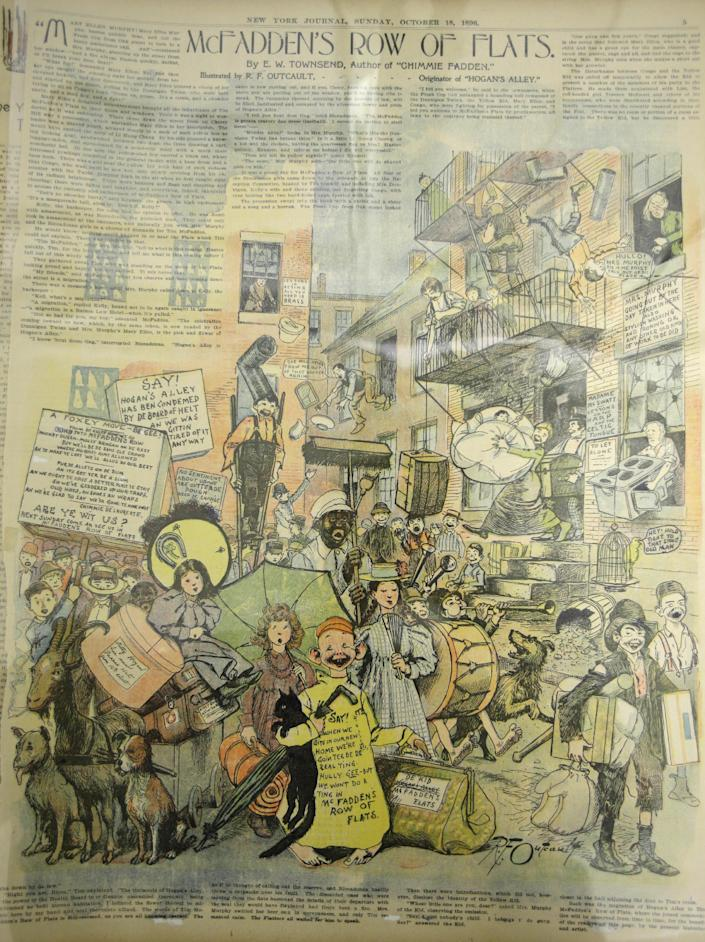 """This Wednesday, Oct. 23, 2013 photo shows a comic called """"Hogan's Alley"""" by Richard F. Outcault from Oct. 18, 1896 in Columbus, Ohio. The Billy Ireland Cartoon Library and Museum, named for the former Columbus Dispatch editorial cartoonist whose family donated millions for project, includes 13,000 square feet of archives stored on rows and rows of motorized shelves and a reading room offering public access to almost everything there. (AP Photo/Tony Dejak)"""