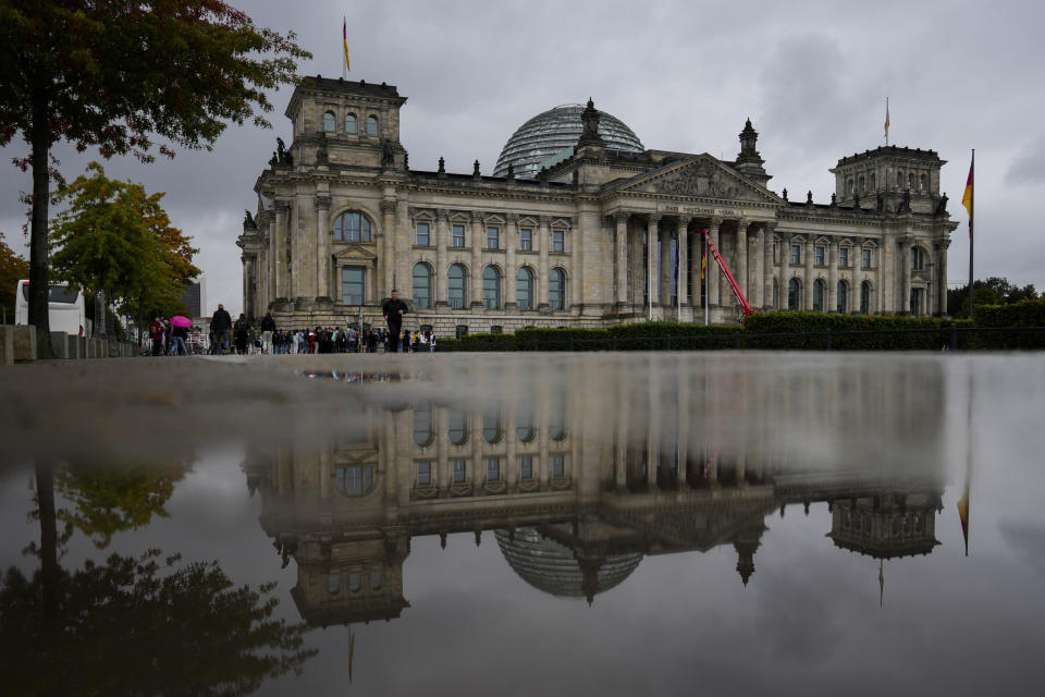 The Reichstag Building which are the German parliament Bundestag building reflected in a puddle in Berlin, Tuesday, Sept. 28, 2021. Sunday's national election making Germany's lower house of parliament, or Bundestag, more diverse and inclusive than ever before. For the first time there are also two transgender women, at least three people of African descent and, after years of stagnation, the number of female lawmakers has gone up again as well. (AP Photo/Markus Schreiber)