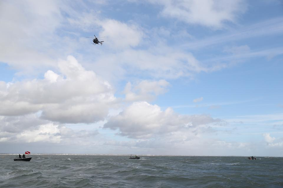 Former paratrooper John Bream attempts a record for highest jump without a parachute by jumping 200ft from a helicopter into the sea off Hayling Island in Hampshire. (Photo by Andrew Matthews/PA Images via Getty Images)