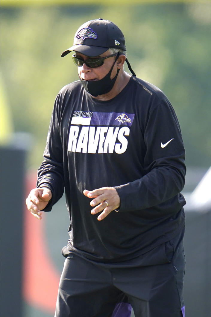 FILE - Baltimore Ravens assistant head coach David Culley works with wide receivers during an NFL football training camp practice in Owings Mills, Md., in this Tuesday, Aug. 25, 2020, file photo. David Culley has been hired as the coach of the Houston Texans, a person familiar with the hiring told The Associated Press. The person spoke to the AP on condition of anonymity Wednesday night, Jan. 27, 2021, because the hiring hasn't been announced. (AP Photo/Julio Cortez, File)