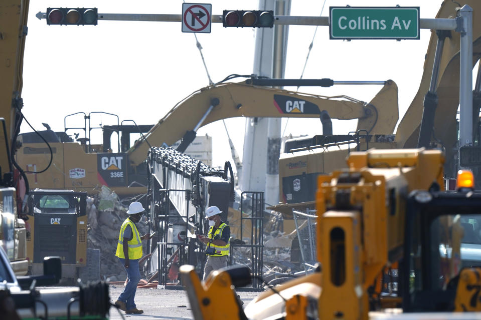 Crews work in the rubble of the Champlain Towers South building, as removal and recovery work continues at the site of the partially collapsed condo building, Tuesday, July 13, 2021, in Surfside, Fla. (AP Photo/Lynne Sladky)