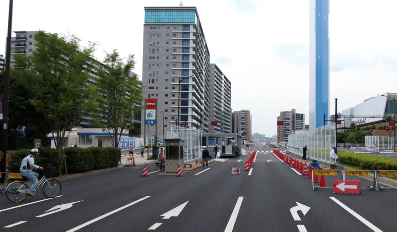 Workers build security checkpoint at the entrance to the Athletes Village in preparation for the Tokyo 2020 Olympic Games in Tokyo