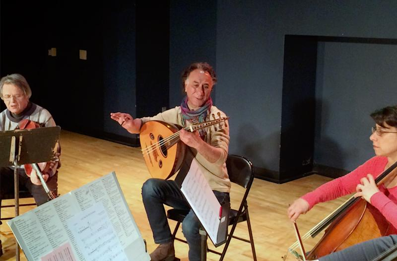 Iraqi American composer and musician Rahim AlHaj, center, rehearses in Dearborn, Mich., Thursday, March 23, 2017. He composed a series of pieces based on the letters of eight Iraqis sharing personal tales during wartime. (AP photo/Jeff Karoub)