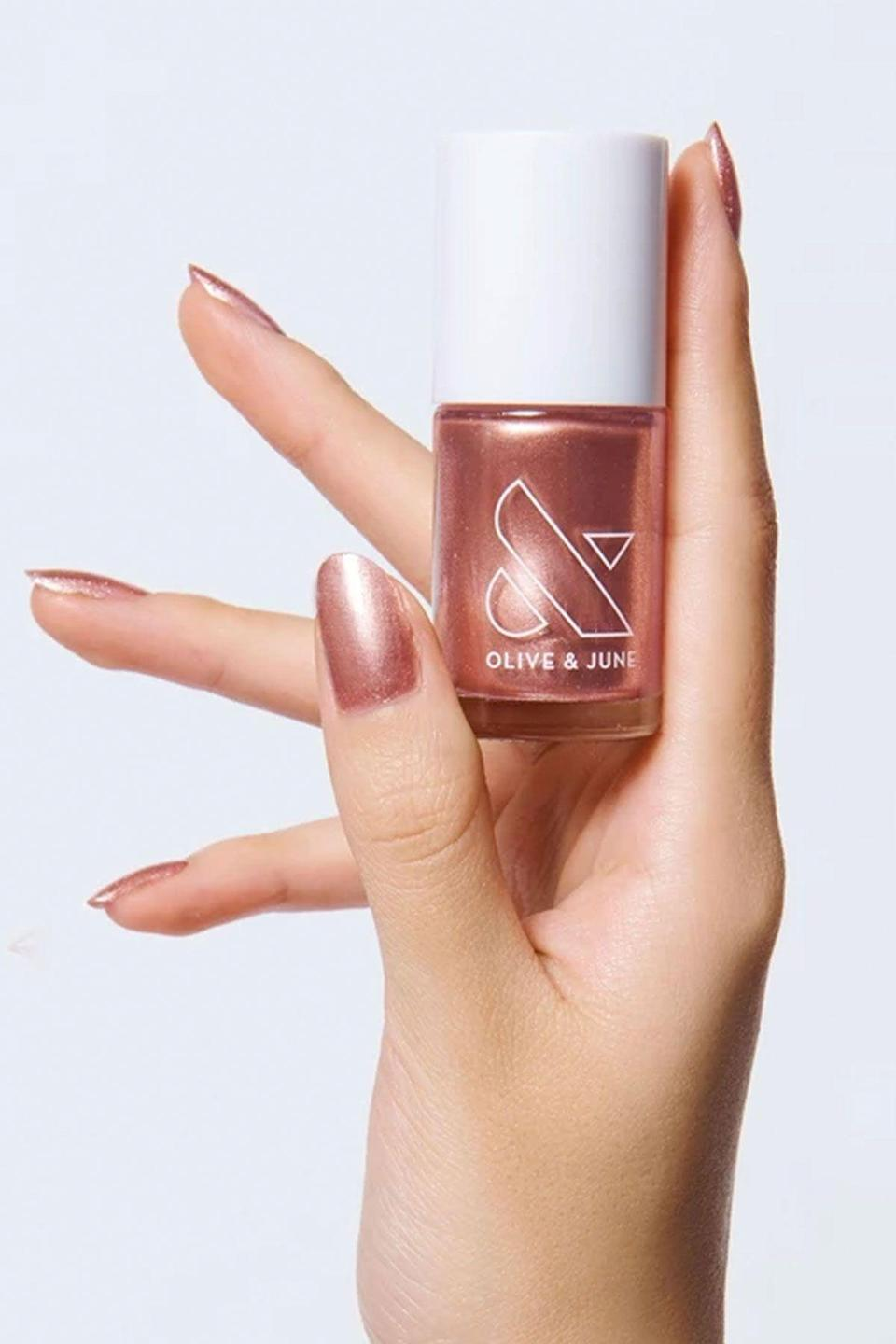 """<p><strong>OPI</strong></p><p>oliveandjune.com</p><p><strong>$8.00</strong></p><p><a href=""""https://go.redirectingat.com?id=74968X1596630&url=https%3A%2F%2Foliveandjune.com%2Fcollections%2Fnail-polish%2Fproducts%2Fojsm&sref=https%3A%2F%2Fwww.seventeen.com%2Fbeauty%2Fnails%2Fg25243032%2Fwinter-nail-polish-colors%2F"""" rel=""""nofollow noopener"""" target=""""_blank"""" data-ylk=""""slk:Shop Now"""" class=""""link rapid-noclick-resp"""">Shop Now</a></p><p>Nothing says holiday party like a glittery metallic. This gorge rose gold will have everyone asking where you get your nails done.</p>"""