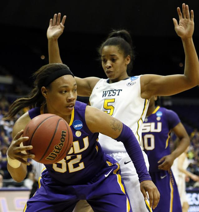LSU guard Danielle Ballard (32) tries to dribble past the defense of West Virginia forward Averee Fields (5) in the second half of an NCAA college basketball second-round tournament game Tuesday, March 25, 2014, in Baton Rouge, La. LSU won 76-67. (AP Photo/Rogelio V. Solis)