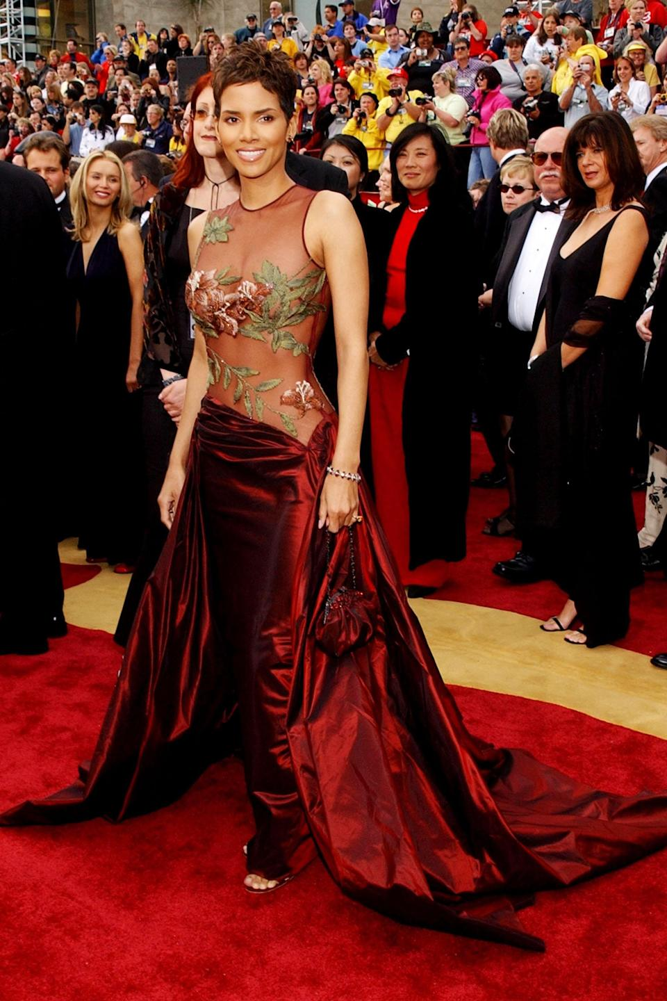 """<h2>Halle Berry, 2002</h2><br>To become the first Black woman to win Best Actress, Halle Berry eliminated her competition — both on the red carpet and the stage — in this Elie Saab gown.<br><br><em>Halle Berry in Elie Saab.</em><span class=""""copyright"""">Photo: Kevin Mazur/WireImage/Getty Images. </span>"""
