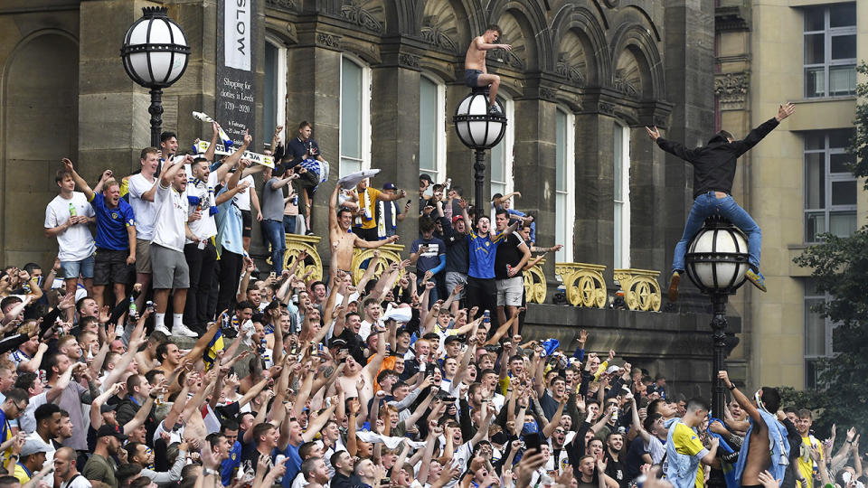 Leeds United fans, pictured here celebrate after winning the Championship title.