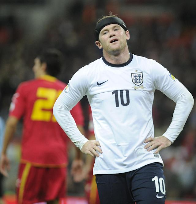 FILE - This Friday, Oct. 11, 2013 file photo shows England's Wayne Rooney after missing a chance to score a goal during the World Cup Group H qualification soccer match between England and Montenegro at Wembley stadium in London . (AP Photo/Bogdan Maran, File)