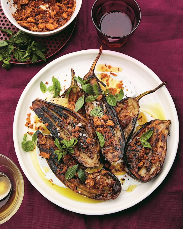 """Eggplant absorbs olive oil like no other vegetable, and we love it just for that reason. This dish from Alison Roman's <a href=""""https://www.amazon.com/Nothing-Fancy-Unfussy-Having-People/dp/0451497015"""" rel=""""nofollow""""><em>Nothing Fancy</em></a> starts with simply halved eggplants, cooked in loads of olive oil until custardy. You serve them on a tangy lemon-labne sauce, with a sprinkle of crunchy olive oil-fried croutons. <a href=""""https://www.epicurious.com/recipes/food/views/long-roasted-eggplant-with-garlic-labne-and-tiny-chile-croutons?mbid=synd_yahoo_rss"""">See recipe.</a>"""
