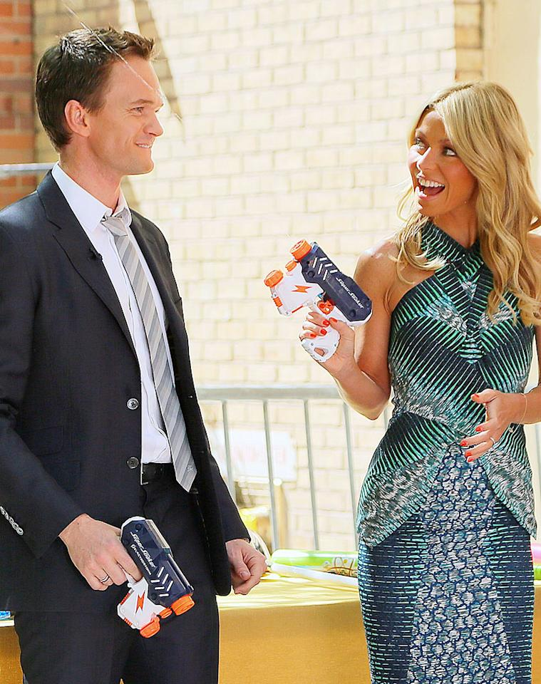 "Kelly Ripa and her guest ""Live!"" co-host Neil Patrick Harris engaged in a watergun fight on Thursday, but that wasn't the only fun they had. The two also rode tricycles, swung baseball bats, and did the limbo on Thursday. Did she have this good of a time with Regis? (6/7/2012)"