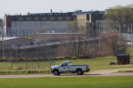 A prison vehicle drives past the Souza Baranowski Correctional Center in Shirley, Massachusetts, U.S., where former New England Patriots player Aaron Hernandez was found dead in his jail cell April 19, 2017.   REUTERS/Brian Snyder