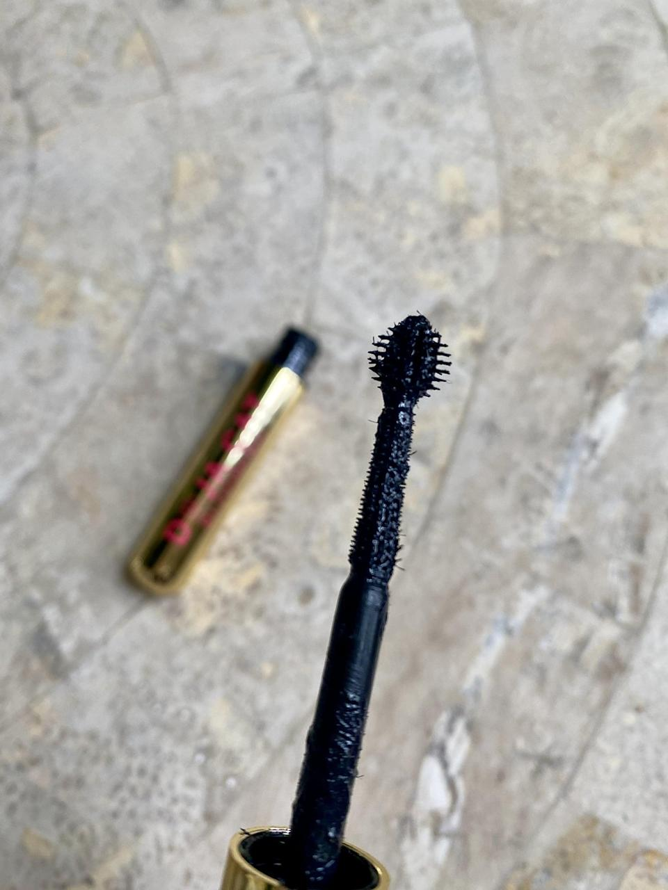 <p>The formula of the <span>BH Cosmetics x Doja Cat Blooming Mascara</span> ($16) is more on the wet side, and the innovative wand has stiff micro-bristles all around it, from the globe to the middle of the wand. However, the first thing I noticed when I used the mascara was that there was a lot of product on my wand. I couldn't use that middle section of the wand, but it didn't really matter to me since I was more intrigued by the globe portion. I highly suggest wiping off the excess, especially if you are used to drier formulas. </p>