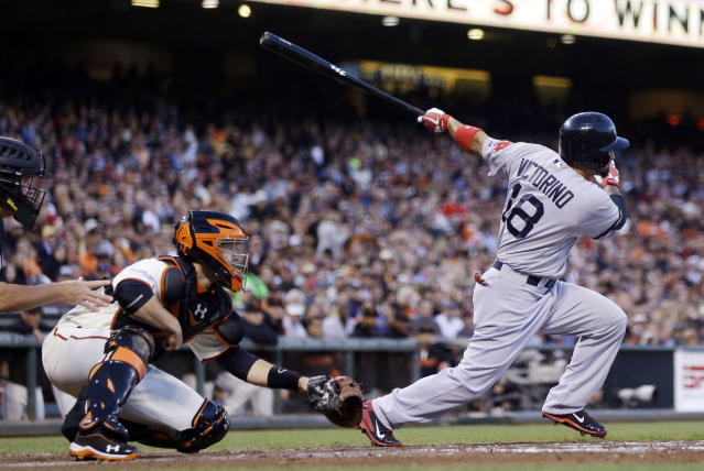 Boston Red Sox's Shane Victorino drives in a run with a single against the San Francisco Giants during the second inning of a baseball game on Monday, Aug. 19, 2013, in San Francisco. (AP Photo/Marcio Jose Sanchez)