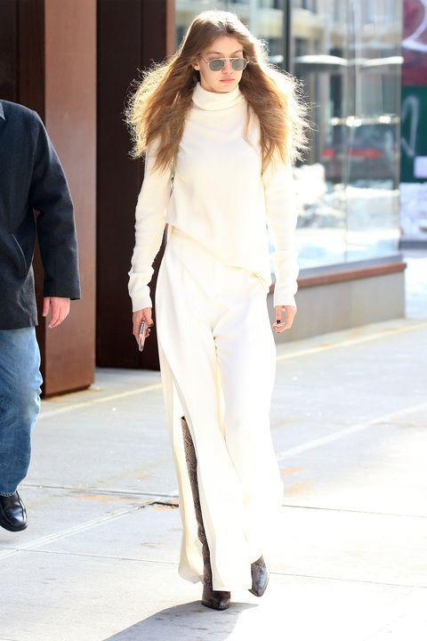 <p>In a Stephanie Rad oversized ivory cashmere turtleneck, slitted high waisted wide leg trousers and knee high snakeskin pointed boots while out in New York. </p>