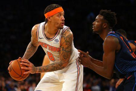 Dec 16, 2017; New York, NY, USA; New York Knicks small forward Michael Beasley (8) controls the ball against Oklahoma City Thunder small forward Jerami Grant (9) during the fourth quarter at Madison Square Garden. Mandatory Credit: Brad Penner-USA TODAY Sports