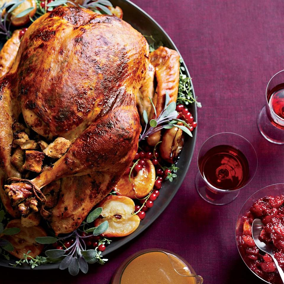 """<p>As if the turkey weren't flavorful enough thanks to the the aromatic shallot-sage butter it's rubbed with, it's also filled with a country bread stuffing made of fresh herbs, Fuji apples, and crumbled chestnuts. Open-fire roasting optional. <a href=""""http://www.foodandwine.com/recipes/roast-turkey-with-chestnut-apple-stuffing"""" rel=""""nofollow noopener"""" target=""""_blank"""" data-ylk=""""slk:Learn how to make Food & Wine's Roast Turkey With Chestnut-Apple Stuffing here."""" class=""""link rapid-noclick-resp""""><b>Learn how to make Food & Wine's Roast Turkey With Chestnut-Apple Stuffing here</b>.</a> <i>Photo: Con Poulos/Food & Wine</i></p>"""