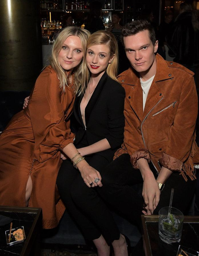 WEST HOLLYWOOD, CA - FEBRUARY 08: Editor in Chief of InStyle Laura Brown, Katherine McNamara and Luke Baines attend InStyle and Motown Records Badass Women Event hosted by Ethiopia Habtemariam and Laura Brown on February 8, 2019 in Los Angeles, sponsored by Fiji Water, Lyft and John Hardy. at Hyde Lounge on February 8, 2019 in West Hollywood, California. (Photo by Charley Gallay/Getty Images for InStyle) | Charley Gallay/Getty Images