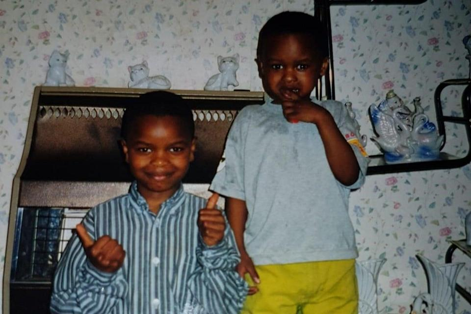 <p>Yaya Mbye Sankareh (left) and his younger brother as children</p> (Handout)