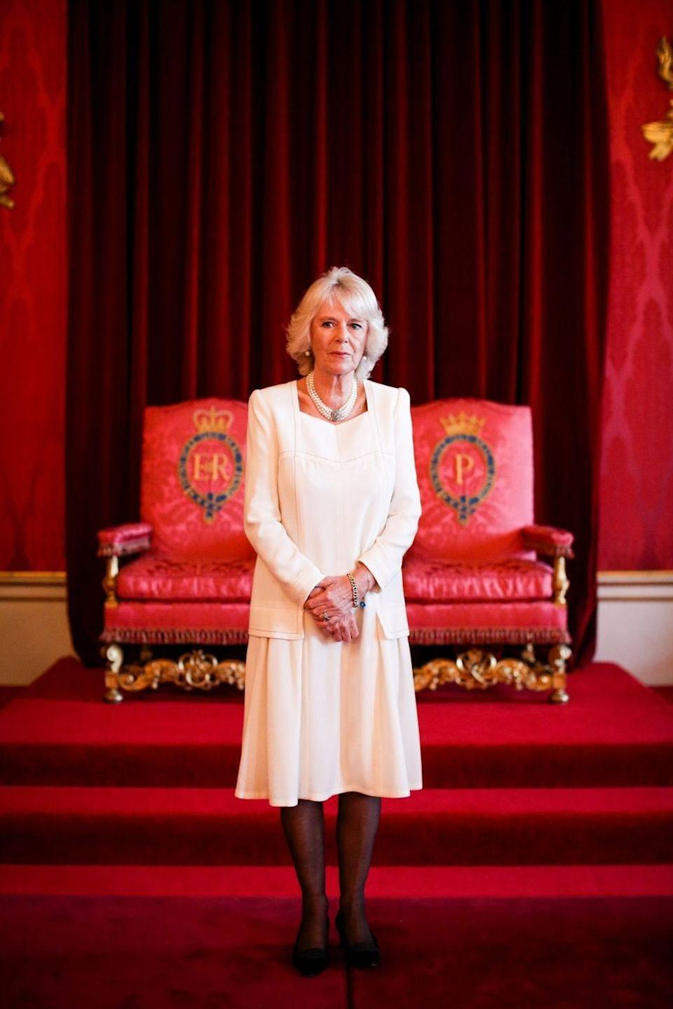 <p>Camilla hosted a reception for participants in an essay competition at Buckingham Palace wearing this understated cream dress with black hosiery and her three-strand pearl necklace. </p>