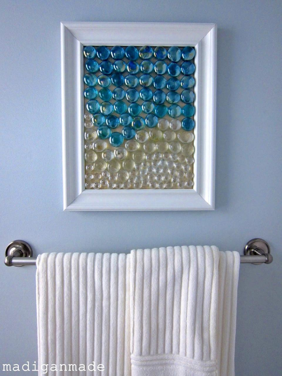 "<div class=""caption-credit""> Photo by: Madigan Made</div><b>Glass Gems</b> <br> Use pretty glass gems in a frame to make fun wall art for your home. The transparent colors give the impression of water and look especially great in a bathroom or kitchen. <br> <i><a href=""http://www.madiganmade.com/2011/03/beachy-glass-gem-wall-art-waters-edge.html"" rel=""nofollow noopener"" target=""_blank"" data-ylk=""slk:Get the tutorial"" class=""link rapid-noclick-resp"">Get the tutorial</a></i> <br> <b>More on Babble</b> <br> <a href=""http://www.babble.com/toddler-times/2012/08/17/20-awesome-home-decor-ideas-using-chalkboard-paint/?cmp=ELP