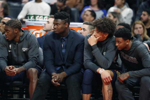 New Orleans Pelicans forward Zion Williamson, second from left, watches with teammates during the second half of an NBA basketball game against the Detroit Pistons, Monday, Jan. 13, 2020, in Detroit. (AP Photo/Carlos Osorio)