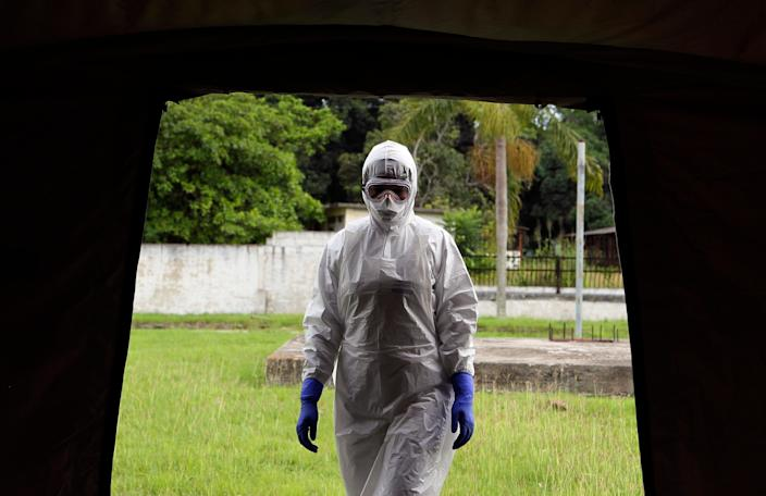 Nurse Dalila Martinez, a trainer for a Cuban medical team of 160 to travel to Sierra Leone to fight Ebola, participates in a practice drill in Havana, Cuba, Sept. 24, 2014.