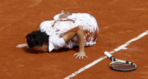 FILE - In this June 5, 2010, file photo, Italy's Francesca Schiavone kisses the court after defeating Australia's Samantha Stosur during a women's final match at the French Open tennis tournament at Roland Garros stadium in Paris. (AP Photo/Michel Spingler, File)