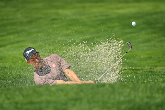 Adam Scott of Australia plays a shot from a bunker on the first hole during the first round of the 2019 PGA Championship at the Bethpage Black course on May 16, 2019 in Farmingdale, New York. (Photo by Mike Ehrmann/Getty Images)