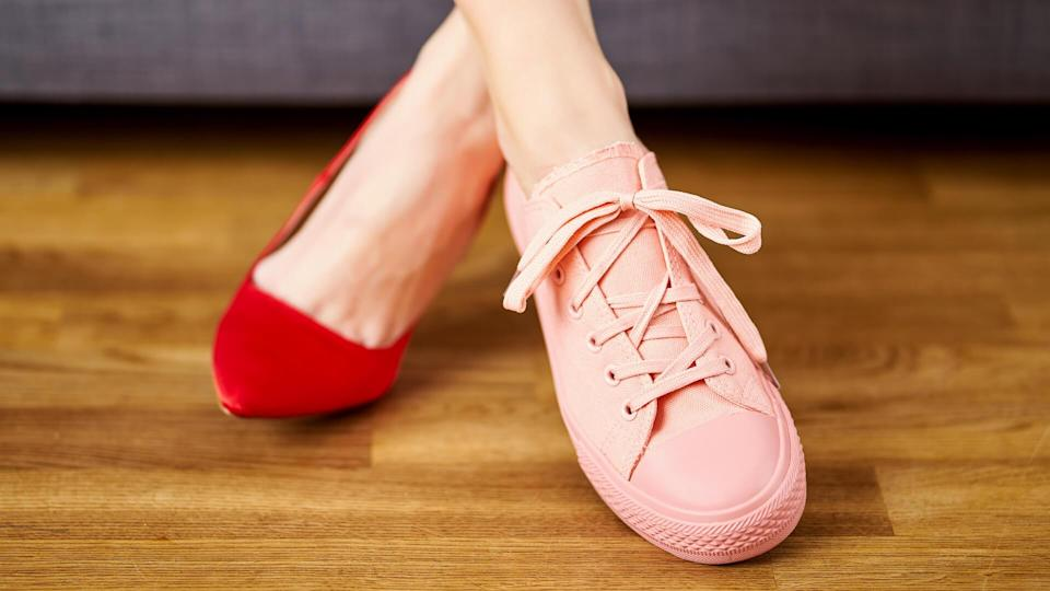 woman wearing two different shoes