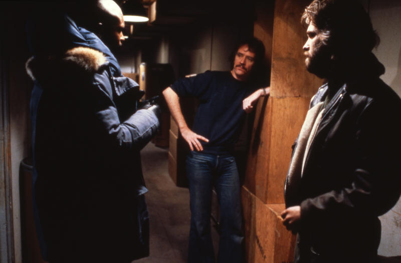 """Keith David, John Carpenter and Kurt Russell on the set of """"The Thing"""". (Photo by Sunset Boulevard/Corbis via Getty Images)"""