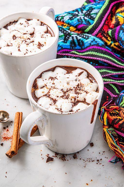 """<p>When it's bone-chillingly cold, nothing warms us up faster than a mug of <a href=""""https://www.delish.com/uk/cocktails-drinks/a31109876/best-hot-chocolate-recipe/"""" rel=""""nofollow noopener"""" target=""""_blank"""" data-ylk=""""slk:hot chocolate"""" class=""""link rapid-noclick-resp"""">hot chocolate</a>. We love the addition of cinnamon and cayenne in this Mexican version, meant for true spice lovers. If you prefer your drinks on the milder side, feel free to forgo the cayenne in favour of a spice that adds less heat, like chilli powder. </p><p>Get the <a href=""""https://www.delish.com/uk/cooking/recipes/a35010469/mexican-hot-chocolate-recipe/"""" rel=""""nofollow noopener"""" target=""""_blank"""" data-ylk=""""slk:Mexican Hot Chocolate"""" class=""""link rapid-noclick-resp"""">Mexican Hot Chocolate</a> recipe.</p>"""