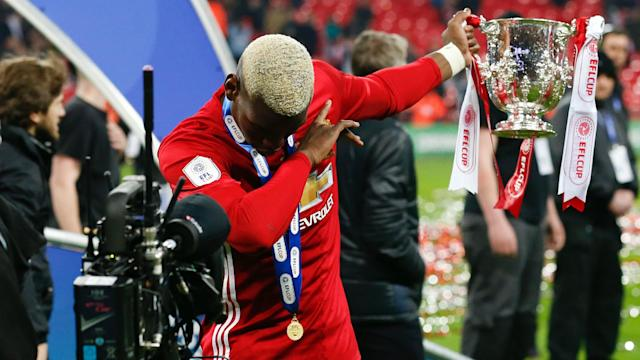 Manchester United midfielder Paul Pogba has impressed the club's former star Paul Scholes in his first season back at Old Trafford.